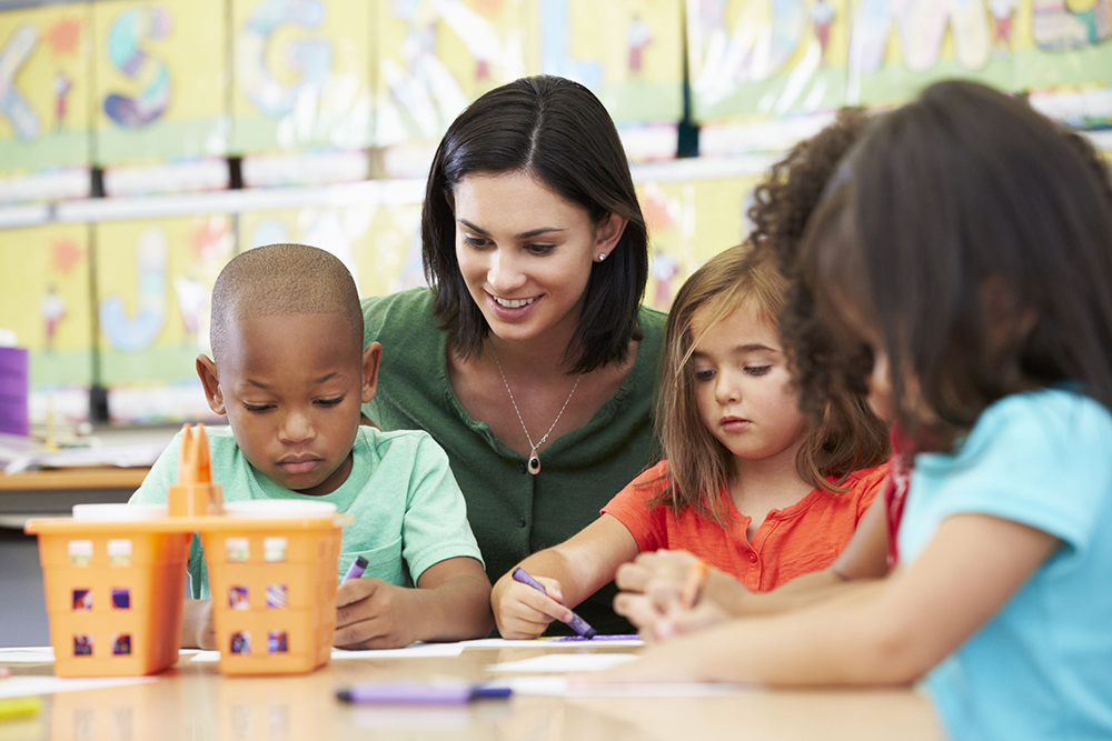 24488422 - group of elementary age children in art class with teacher